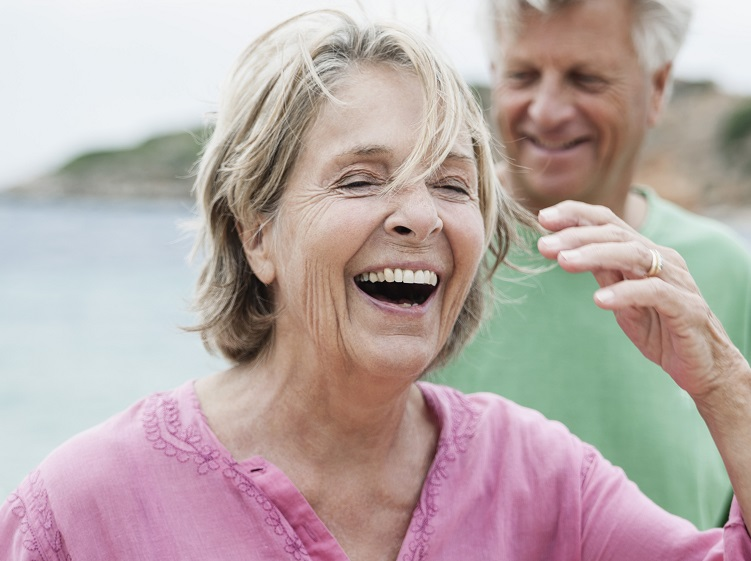 woman laughing with man behind